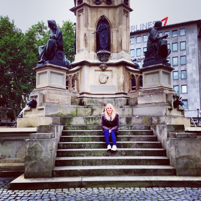 Being a tourist in front of an ornate German water fountain